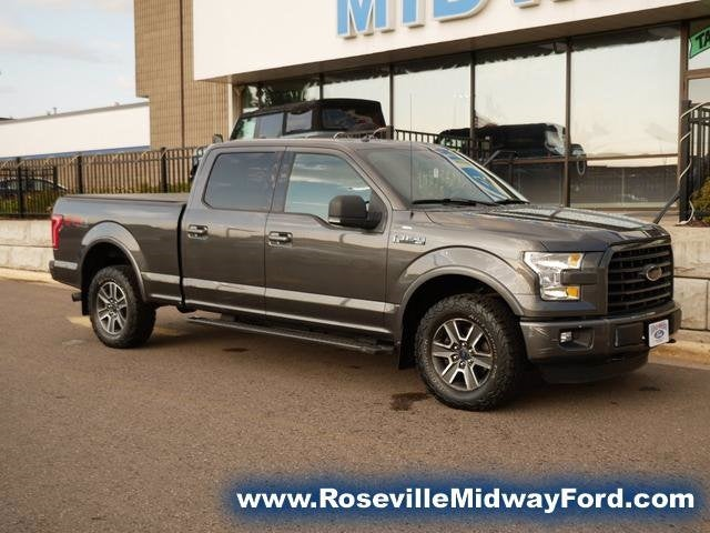 Used 2015 Ford F-150 XLT with VIN 1FTFW1EF0FFC61999 for sale in Roseville, Minnesota
